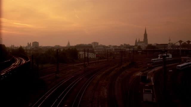 trains move through a train yard in ulm, germany. - バーデン・ビュルテンベルク州点の映像素材/bロール