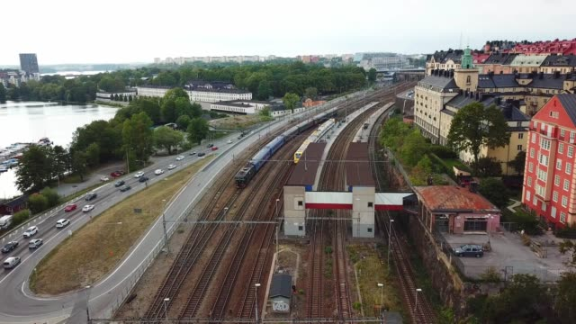 trains moving in city, stockholm, sweden - rail transportation stock videos & royalty-free footage