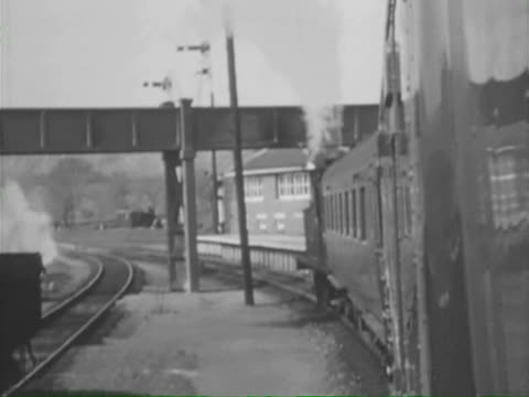 ms cu ts trains moving slowly at station southampton, london and brighton, england  - southampton england stock videos and b-roll footage