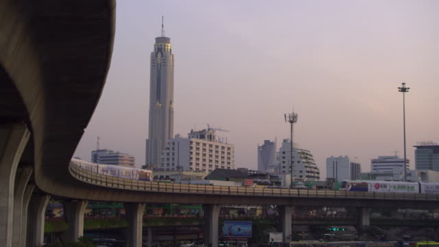 ws ha trains on overpass with cityscape in background, bangkok, ayuthaya, thailand - see other clips from this shoot 1448 stock videos and b-roll footage