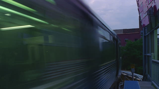 t/l cu el trains passing on curving tracks at dusk / chicago, illinois - chicago 'l' stock videos & royalty-free footage