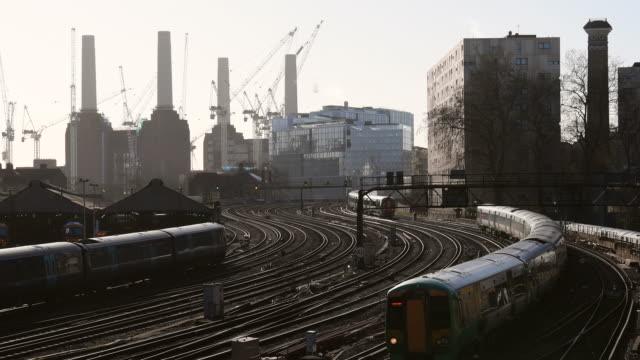 trains travel on the railway tracks near victoria station on february 16, 2018 in london, england. - cable stock videos & royalty-free footage