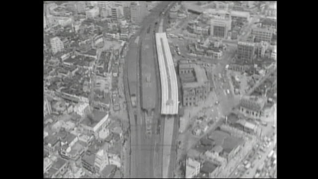 Trains travel past the Shimbashi Station in Tokyo, Japan.