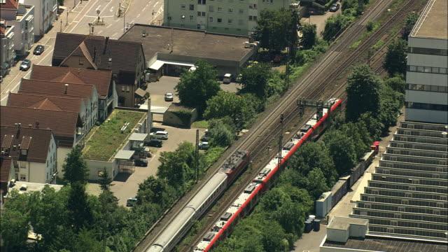 aerial trains traveling through suburbs, stuttgart, baden wurtenberg, germany - passenger train stock videos & royalty-free footage