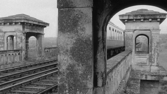 vídeos y material grabado en eventos de stock de montage trains traveling through the countryside, over bridges and viaducts, and arriving at a station crowded with commuters / united kingdom - yorkshire