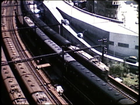 1963 montage trains travelling and workers commuting / japan  - showa period stock videos & royalty-free footage