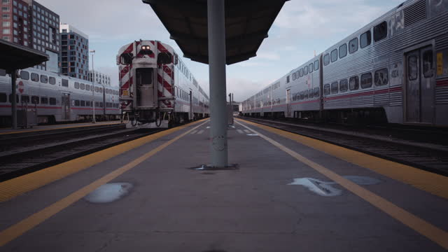 trains wait at empty station - general motors stock videos & royalty-free footage