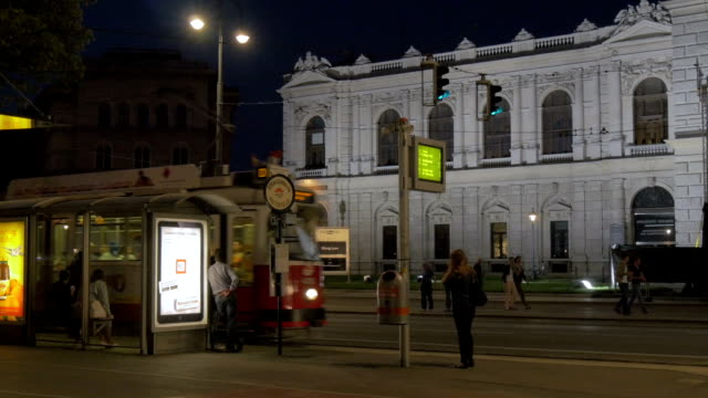 Tram at night entering station outside Burg Theatre