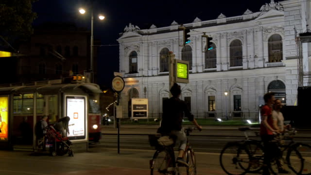 tram at night entering station outside burg theatre - austria stock videos and b-roll footage