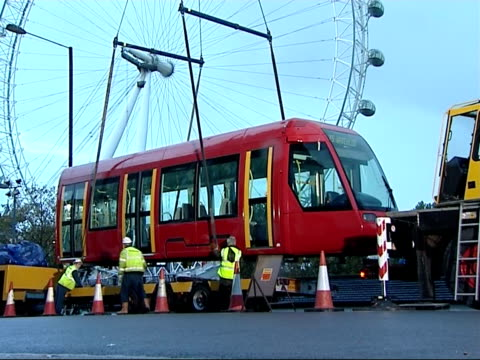 tram carriage on show on southbank vars of workmen hoisting tram carriage into position with aid of crane - hoisting stock videos & royalty-free footage