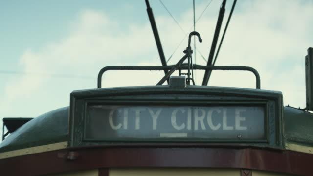 cu tram driving away, melbourne, victoria, australia - tram stock videos & royalty-free footage