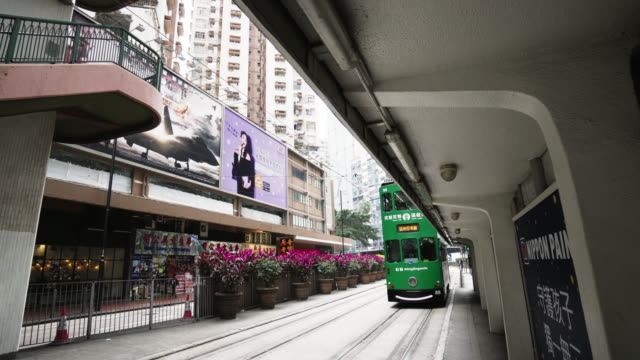 tram entering the tram stop / hong kong - narrow stock videos & royalty-free footage