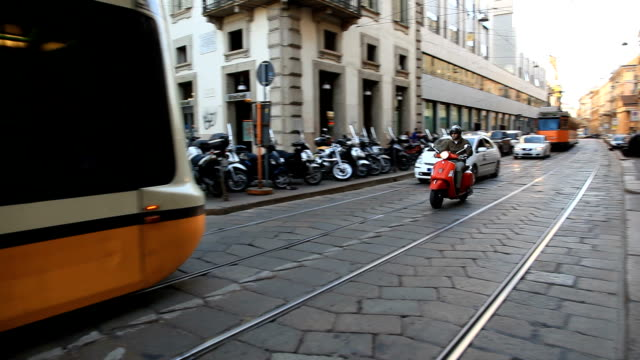 TRACK PAN Tram going through streets of Milano/ Italy