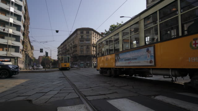 Tram going through streets of Milano Italy