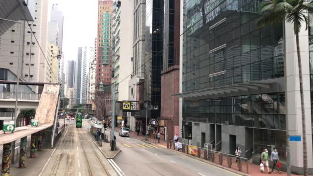 vidéos et rushes de tram hong kong - amirauté à wan chai arsenal street - ligne de tramway