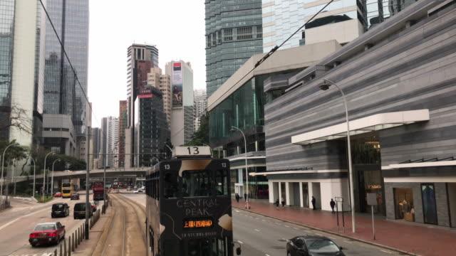 vidéos et rushes de tram hong kong - amirauté à wan chai - ligne de tramway