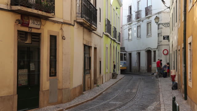 ws tram in narrow alley / lisbon, portugal - narrow stock videos and b-roll footage
