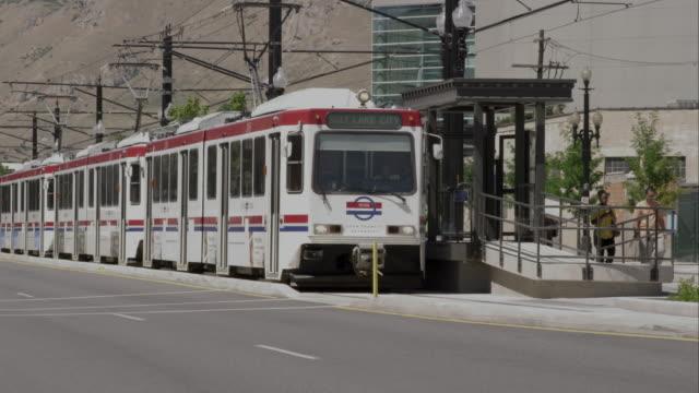 Tram in Salt Lake City leaving stop.