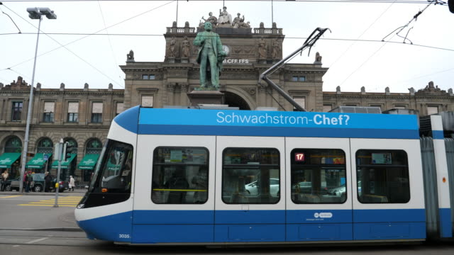 tram in zürich at main station - station stock-videos und b-roll-filmmaterial