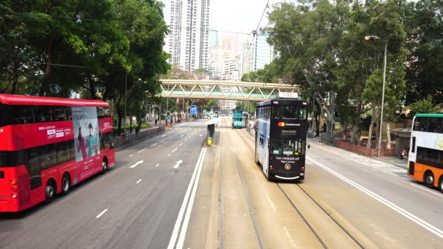 tram journey outside victoria park, tramway hong kong island - hong kong island stock videos & royalty-free footage