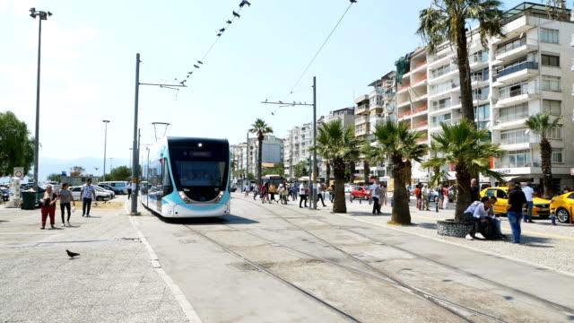 vídeos de stock e filmes b-roll de tram line in  i̇zmir - linha do elétrico