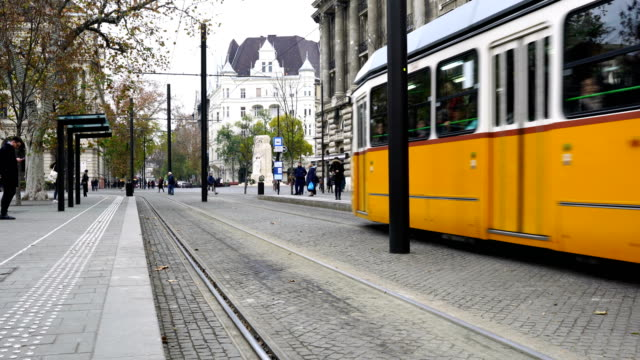 tram moves along danube river in budapest, hungary - cultura ungherese video stock e b–roll