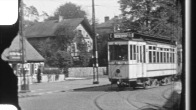 "tram of berlin driving, tram 5414 to ""konradshöhe"", bycicles crossing the street in front of the electric tramway - tram stock videos & royalty-free footage"