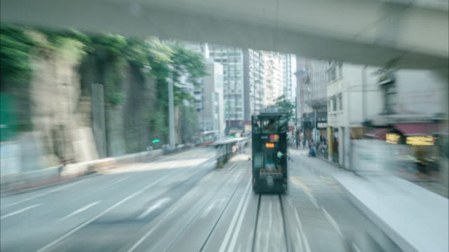 tram on a hong kong street (tram view). - wan chai stock videos & royalty-free footage
