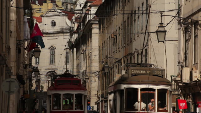 ms tram on narrow old town street / lisbon, portugal - narrow stock videos and b-roll footage