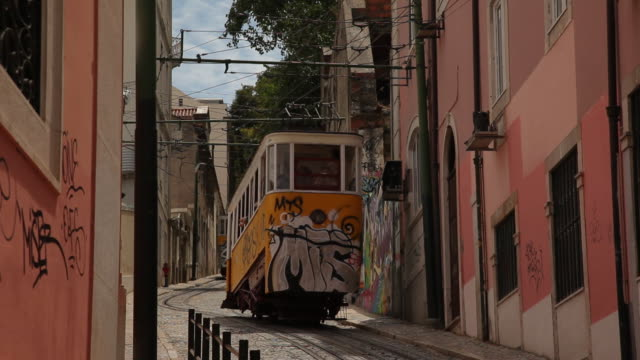 MS Tram on narrow old town street / Lisbon, Portugal