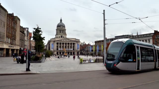 a tram paces nottingham council house nottingham in tier two as the government looks at placing more restrictions on the city with rising coronavirus... - commercial land vehicle stock videos & royalty-free footage