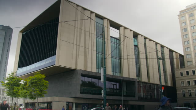 A tram passes in front of Tūranga, Christchurch Central Library