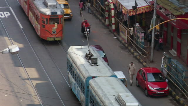 WS Tram passing through street  / Kolkata, West Bengal, India