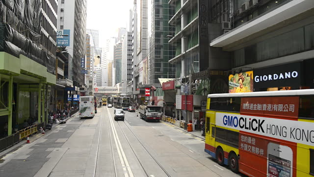 t/l wa pov of tram racing through downtown hong kong - tram stock videos & royalty-free footage