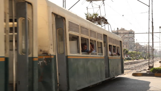 tram running through the city. cairo is the capital city of egypt. it is home to 9.5 million people who predominantly follow islam. - tram stock videos & royalty-free footage