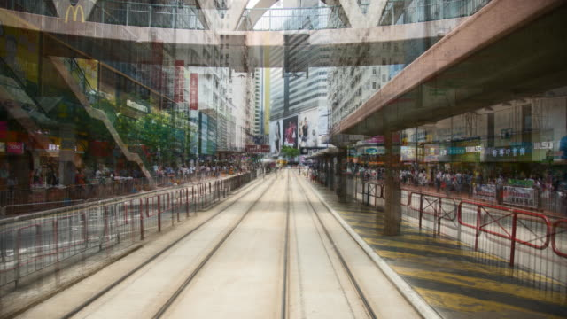 tram speeding through hong kong - wanchai stock videos and b-roll footage