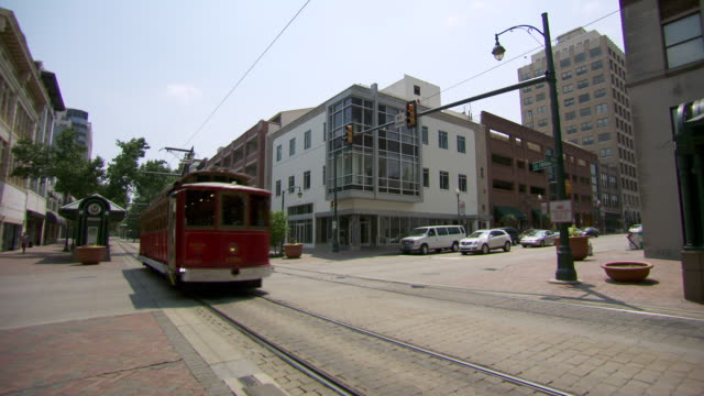 WS Tram train moving toward in city / Memphis, Tennessee, United States