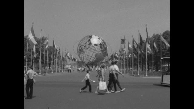tramcar navigates through the 1964/1965 worldõs fair, passing the unisphere located in flushing meadows park in queens, new york. - unisphere stock videos & royalty-free footage