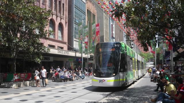 trams are seen on bourke street mall on december 1, 2016 in melbourne, australia. - 路面軌道点の映像素材/bロール