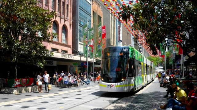 trams are seen on bourke street mall. shots of melbourne's iconic transport system taken on december 01, 2016 in melbourne, australia. - 路面軌道点の映像素材/bロール