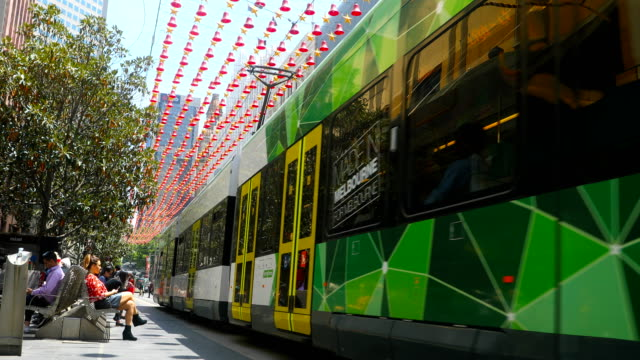 trams are seen on bourke street mall. shots of melbourne's iconic transport system taken on december 01, 2016 in melbourne, australia. - tram stock videos & royalty-free footage