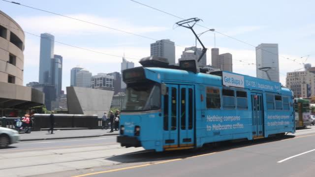 trams are seen on st kilda road on december 1, 2016 in melbourne, australia. - 路面軌道点の映像素材/bロール