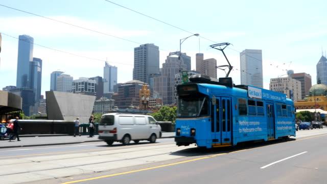 trams are seen on st kilda road. shots of melbourne's iconic transport system taken on december 01, 2016 in melbourne, australia. - 路面軌道点の映像素材/bロール
