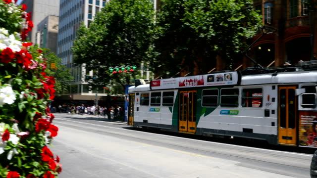 trams are seen on swanstson street. shots of melbourne's iconic transport system taken on december 01, 2016 in melbourne, australia. - 路面軌道点の映像素材/bロール