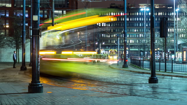 trams in piccadilly gardens, manchester - tram stock videos & royalty-free footage