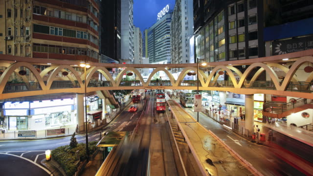 trams moving along the illuminated hennessy road in wan chai near times square at dusk, hong kong island, hong kong, china, time-lapse - times square causeway bay stock videos & royalty-free footage