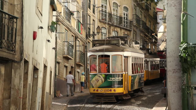 MS Trams on narrow old town street / Lisbon, Portugal