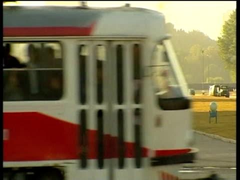 trams pass municipal building in pyongyang; 2005 - pyongyang stock videos and b-roll footage