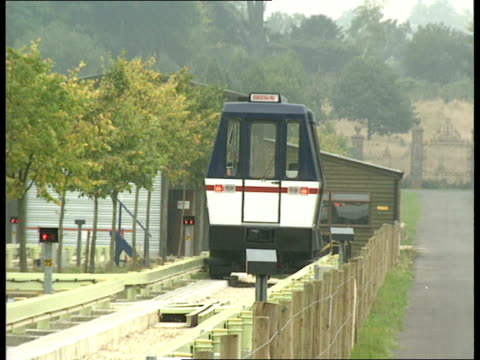 Trams to return to British cities *CR1153 TRAMS Surrey Baynards Park EXT Briway prototype tram train along on track train towards farm buildings pull...