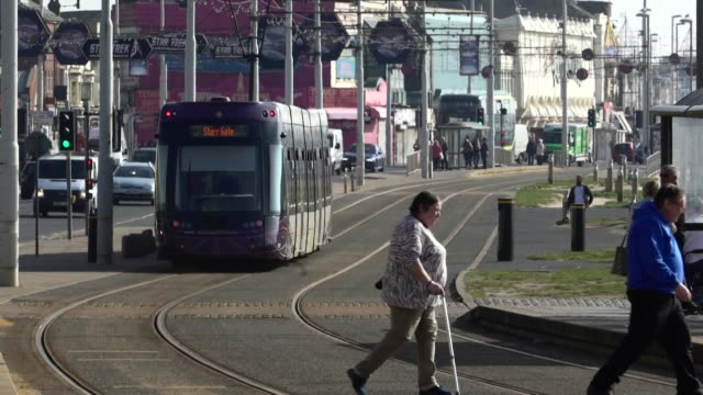 trams travelling along blackpool seafront - tram stock videos & royalty-free footage